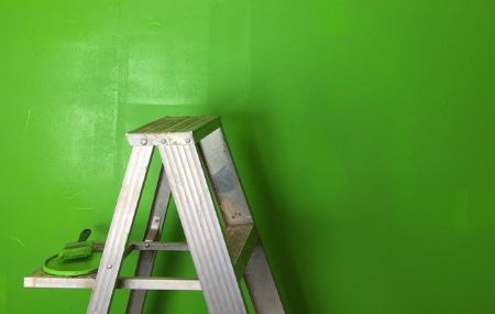 a ladder in front of a green wall thumbnail hero image